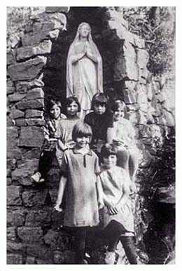 Image of St. Joseph's children gathering at the Grotto of the Blessed Virgin Mary.