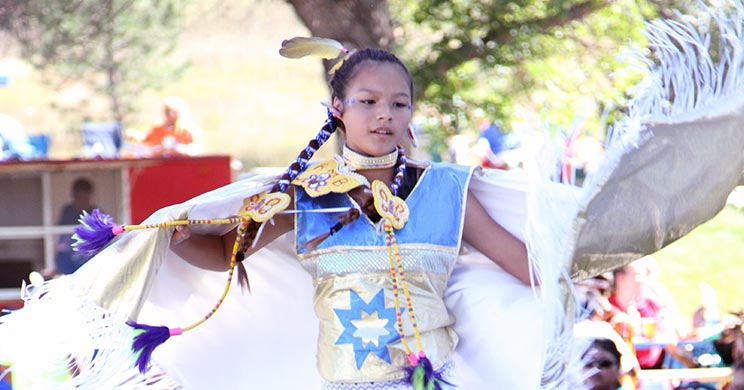 A young female student dances at St. Joseph's annual powwow, an opportunity for others to learn about the Native American culture.