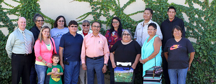 The Parental Advisory Committee poses for a photo after discussions about Native American family integration.