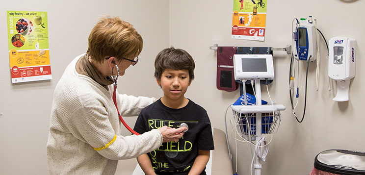 A Native American student's health care needs being met by our staff.